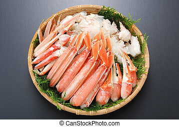Raw fresh cold snow crab pot set with claws, legs, meat and...