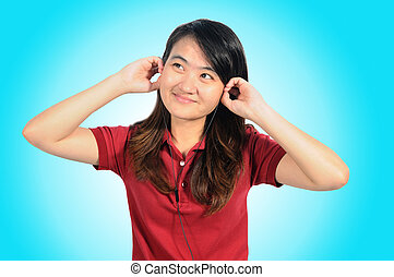 Asian middle woman enjoy with music by earphone of her...