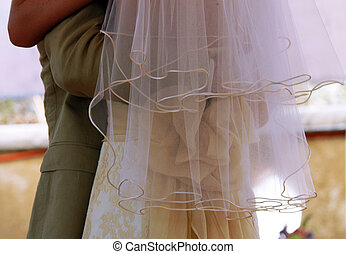 Bridal veil - Detail of just married couple with focus on...