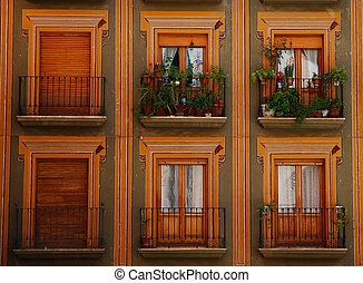 Colored balconies - Warm-colored balconies in Granada