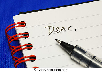 The word Dear with a pen