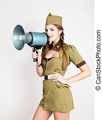 sexy fashionable woman in military uniform and garrison cap,...
