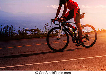 man was cycling with the sun light - young man was cycling...
