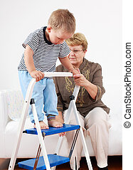 Playing with granny - Cute little boy playing with his...