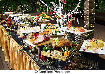 Delightful Christmas buffet with roasted chicken, beef,...