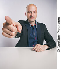 man pointing finger at you