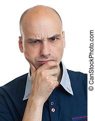 grumpy bald guy - portrait of grumpy bald guy isolated on...