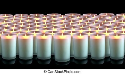 Many white candles on a black background 4K