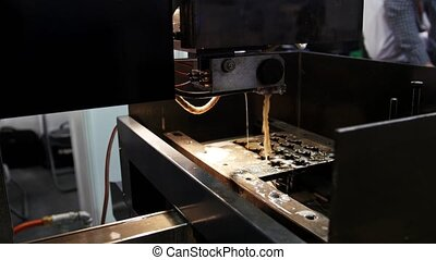 Laser processing at industry - cutting of metal. Sparks fly,...
