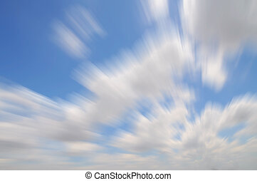 Blue sky with light clouds, motion