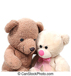 Couple teddy bears hugging on white background.