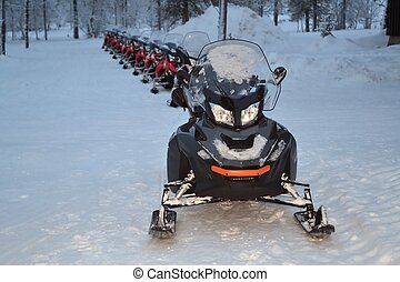 snowmobiles lined up - snowmobiles ready for an excursion in...
