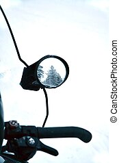 side mirror and handlebar of a snowmobile - snowmobile...