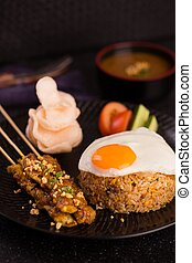 Special rice style of nasi goreng with egg, roasted meat,...