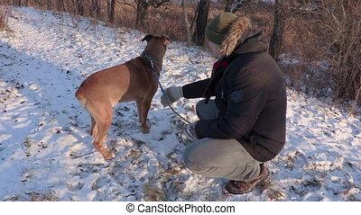 Man talking with dog at outdoor in winter