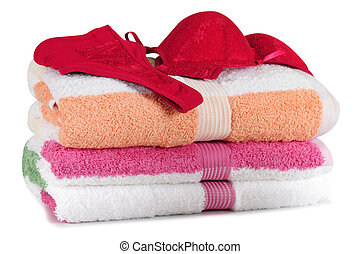 Sensuality. Isolated - Lingerie on bath towels.