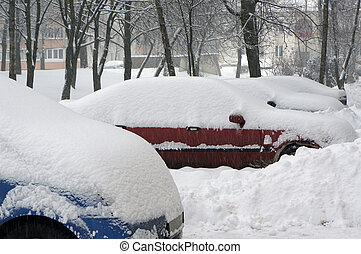 Snow on cars. Winter urban scene. - Snow on cars after...
