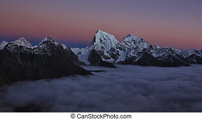 Pink sunset in the Himalayas - High mountains Cholatse and...