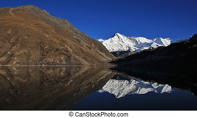 Mount Cho Oyu mirroring in Gokyo lake - Morning scene at...