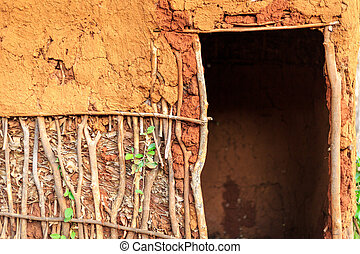 Door to traditional, african house - Entrance to...