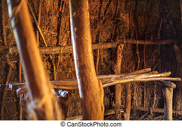 Bed in traditional, tribal hut of Kenyan people, Nairobi