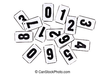 Pile of numbers on metal plate isolated on white - Numbers...