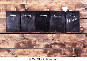 Weekday blackboard notices with a message on Friday saying...