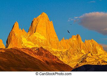 Fiery sunset illuminates the spectacular cliffs Fitz Roy....