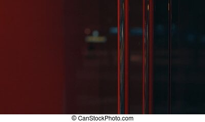 City lights reflected in the red glass door 4K