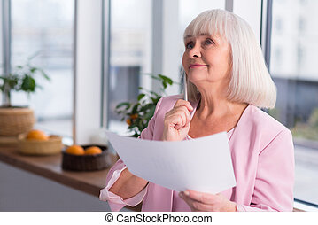 Mature businesswoman thinking about business - This seems...