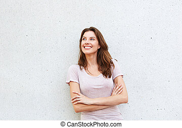 beautiful young lady smiling against white wall - Portrait...