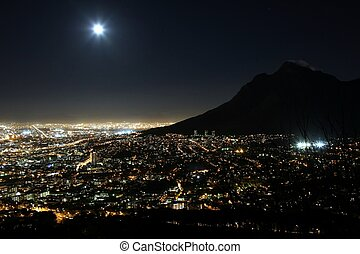 Cape Town City Lights - Cape Town city at night with moon in...