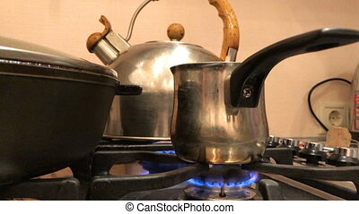 Coffee is brewed on the gas stove close-up