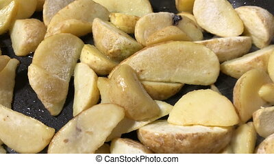 Fried potato slices in a pan