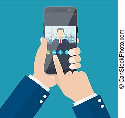 Hands with smartphone. Director communicates with staff ....