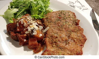 Breaded Roast Palermo Style - Plate with breaded roast...