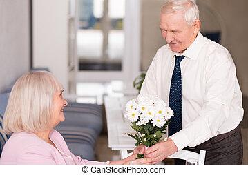 Courteous gentleman holding a bouquet - Nice present....