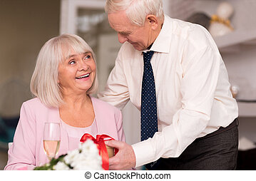 Magnificent smiling woman receiving a present - You should...