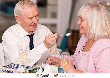Wonderful happy couple having fun in restaurant - Take...