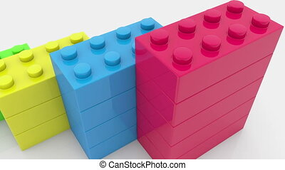 Toy bricks in various colors on white