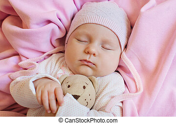 Sweet Little Newborn Baby Sleeping On The Blanket With His...