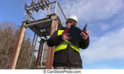 Electrician engineer talking near transformer