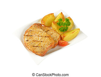 Grilled pork chops with potato wedges