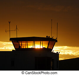Air traffic control tower on sunset sky, France