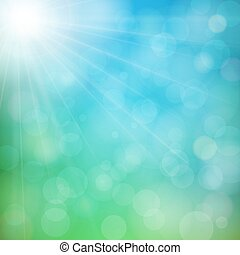 Abstract defocused nature background with blue and green blurred bokeh circles. Summer sun with light rays.