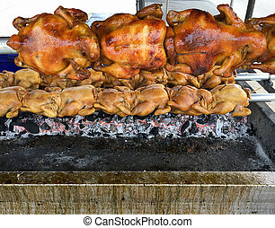 Grilled chicken on the hot charcoal.