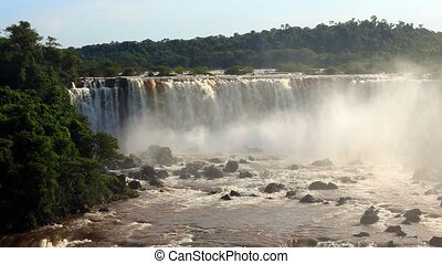 view of worldwide known Iguassu falls at the border of...