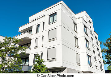 White modern multi-family house seen in Berlin, Germany