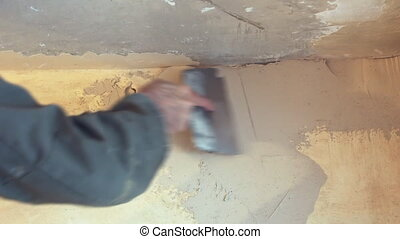 Man plastering wall with spatula 3