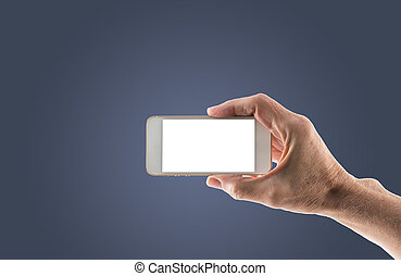 Male right hand holding smartphone with blank screen - Image...